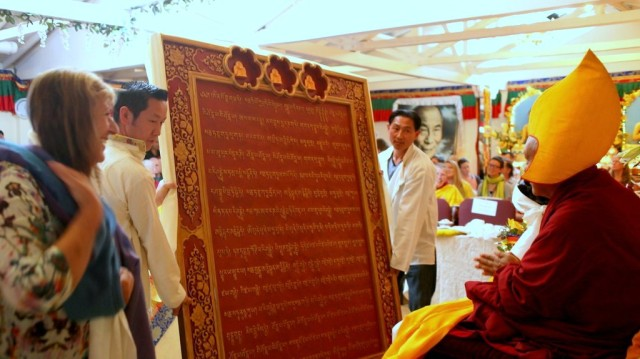 The huge Namgyälma mantra board being presented to Lama Zopa Rinpoche during the long life puja, Land of Medicine Buddha, September 29, 2013. Photo by Ven. Roger Kunsang.