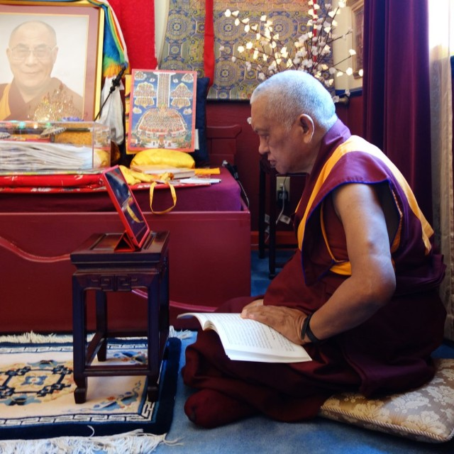 Lama Zopa Rinpoche watching a live webstream of His Holiness the Dalai Lama teaching in New York City, October 18, 2913. Photo by Ven. Roger Kunsang.