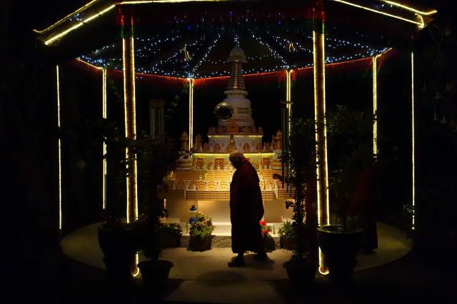 Lama Zopa RinpochecircumambulatingthestupainthebackyardofKachoeDechenLing,California.November 2013. Photo by Ven. Roger Kunsang