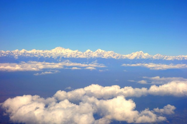 View of the Himalayas from the airplane window, taken during Lama Zopa Rinpoche's journey to Kathmandu, November 22, 2013. Photo by Ven. Roger Kunsang.