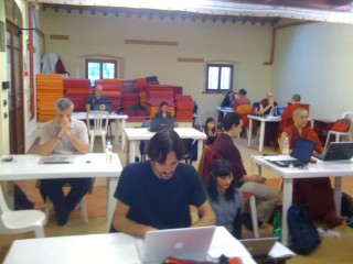 Students from the 2008-2013 FPMT Masters Program cohort sit for their final exams, 2013. Photo courtesy of www.facebook.com/mpretreat.