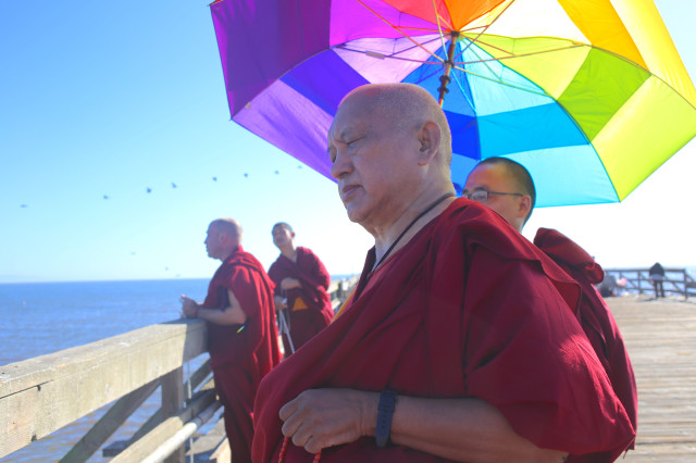 Lama Zopa Rinpoche on wharf near Kachoe Dechen Ling, California, September 2013. Photo by Ven. Thubten Kunsang.