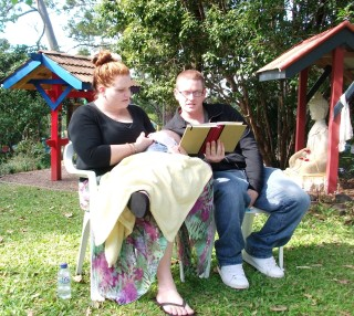 Rebecca and Kurt Rogers doing a reading at their son Knox's naming ceremony. Photo by Christine Foxwell.