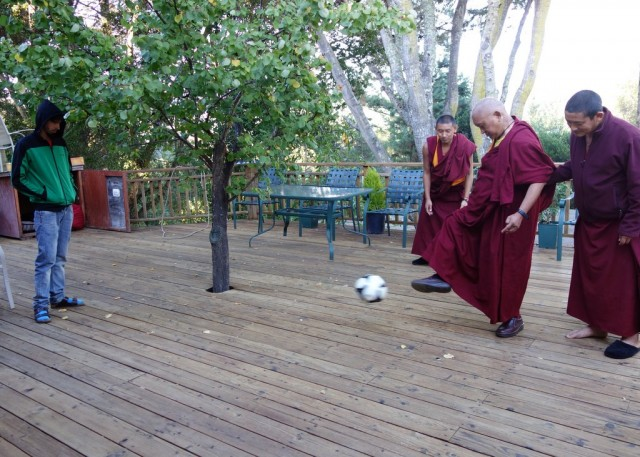Tenzin Osel Hita and Lama Zopa Rinpoche playing with a soccer ball