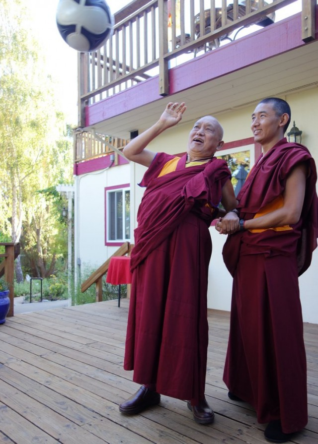 Lama Zopa Rinpoche bats down a soccer ball to improve strength and coordination