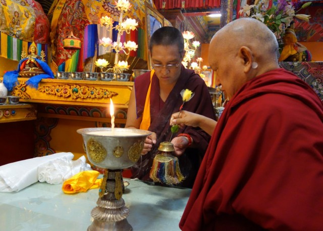 Lama Zopa Rinpoche offering a butter lamp upon arriving at Kopan Monastery, Nepal, November 22, 2013. Photo by Ven. Roger Kunsang.