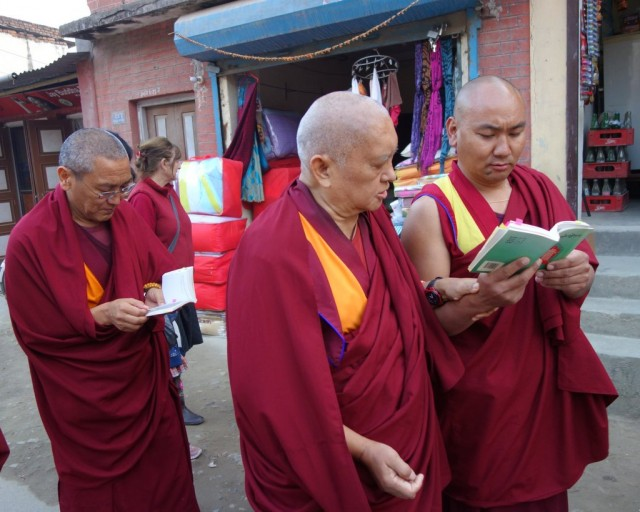 Lama Zopa Rinpoche with Khen Rinpoche Geshe Chonyi and others reading the Vajra Cuttar Sutra while circumambulating the Swayambhunath, Nepal, November 24, 2013. Photo by Ven. Roger Kunsang.