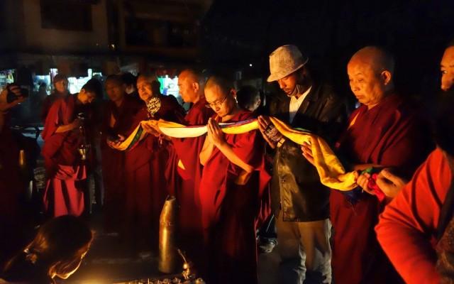 At the end of the 3 kilometre  circumambulation of Swayambhu Stupa, Rinpoche offers 5 colored khata and the Dharmachakra to the Stupa. With Khen Rinpoche Geshe Chonyi, Gen.Tenpa Choden and Kopan monks. November 24, 2013. Photo by Ven.Roger Kunsang.