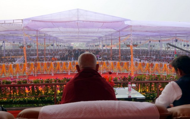 Lama Zopa Rinpoche looking out over the crowd of 100,000, Kushinagar, Uttar Pradesh, India, December 13, 2013. Photo by Ven. Roger Kunsang.