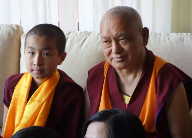 Lama Zopa Rinpoche with the young tulku, Domo Geshe Rinpoche, Sera Monastery, December 2013. Photo by Ven. Roger Kunsang.