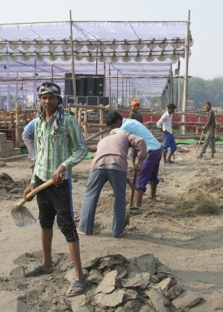 Local workers at event site, Kushinagar, India, December 12, 2013. Photo by Andy Melnic.