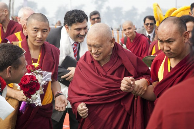 Lama Zopa Rinpoche arriving at foundation stone laying ceremony, Kushinagar, India, December 13, 2013. Photo by Andy Melnic.