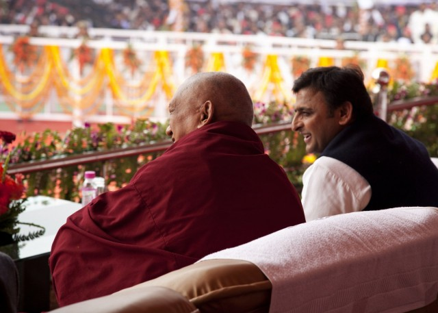 Lama Zopa Rinpoche and Akhilesh Yadav watching program during ceremony, Kushinagar, India, December 13, 2013. Photo by Andy Melnic.