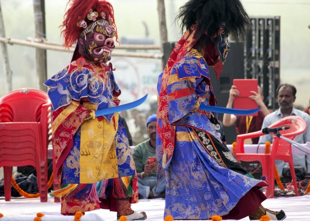 Dancers doing traditional Tibetan dance, Kushinagar, India, December 13, 2013. Photo by Andy Melnic