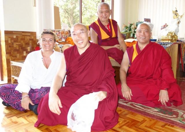 Lama Zopa Rinpoche with Geshe Jampa Gelek and Geshe Tenzin Tenphel (right) and Lara Gatto, Sera Je Monastery, India, January 2014. Photo by Ven. Roger Kunsang.