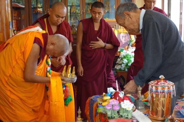 Lama Zopa Rinpoche offering a mandala to KhyonglaRatoRinpoche, Sera Monastery, India, January 2014. Photo by Ven. Roger Kunsang.