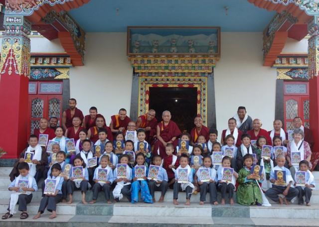 Rinpochewiththechildrenfromthe Ngari Institute of Buddhist Dialectics, Sera Monastery, India, January 2014. Photo byVen.RogerKunsang.