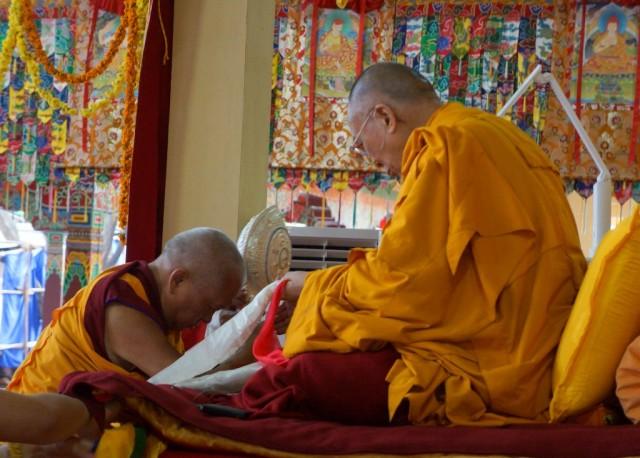 Lama Zopa Rinpoche offering mandala to His Holiness the Dalai Lama, Sera Monastery, Bylakuppe, Karnataka, India, January 2, 2014. Photo courtesy of OHHDL.