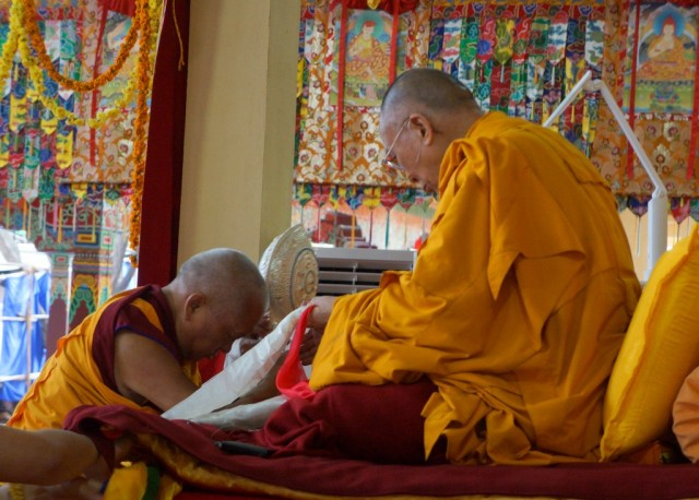 Lama Zopa Rinpoche offering mandala to His Holiness the Dalai Lama, Sera Monastery, Bylakuppe, Karnataka, India, January 2, 2014. Photo courtesy of OHHDL.