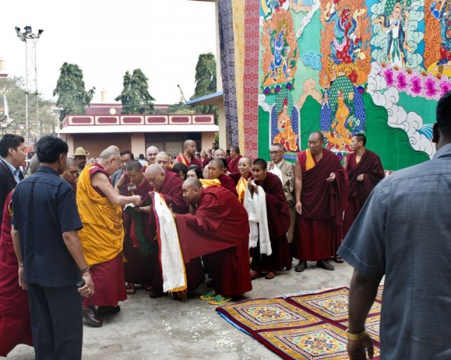 His Holiness the Dalai Lama with Lama Zopa Rinpoche blessing the giant Guru Rinpoche thangka, Sera Monastery, India,  December 29, 2013. Photo copyright Rio Helmi/Jangchup Lamrim Teaching Organizing Committee.