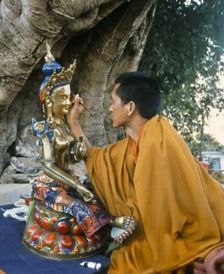 """Lama Zopa Rinpoche """"opens the eyes"""" of the Tara statue, Kopan Monastery, 1976"""