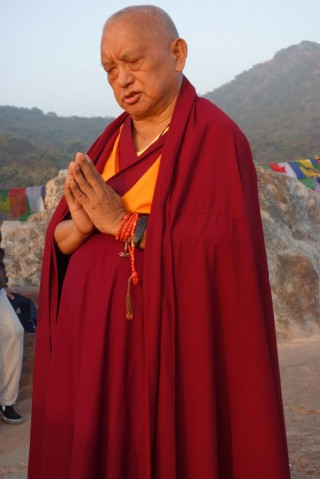 Lama Zopa Rinpoche does prostrations at Vulture's Peak, the site of Buddha's first teaching, India, February 2, 2014. Photo by Ven. Roger Kunsang.
