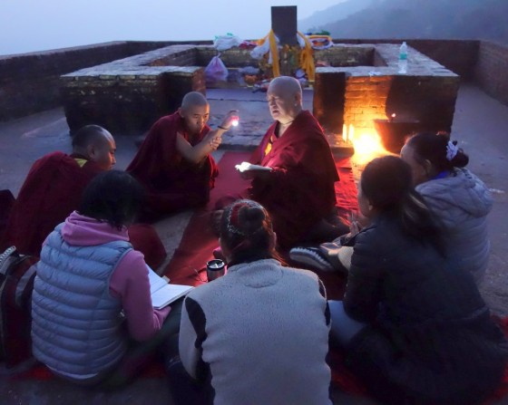 Lama Zopa Rinpoche teaching into the evening on Vulture's Peak, Bihar, India, February 2014. Photo by Ven. Roger Kunsang.