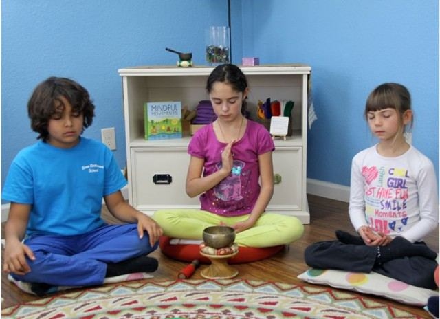 Children use secular rituals to engage with the CCC curriculum. Photo courtesy of Pam Catyon.