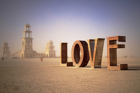 """Burning Man: Spread the LOVE"" by Sarah Bartell (Flickr: Little Lioness), August 2011. Creative Commons Attribution."