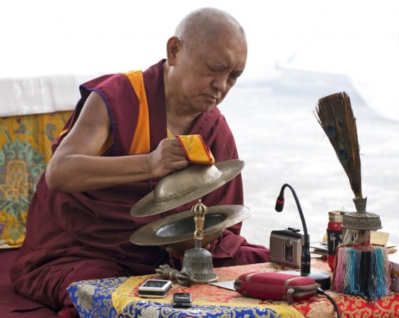 Lama Zopa Rinpoche plays cymbals during a protector insence puja, Root Institute, Bodhgaya, India. March 2014. Photo by Andy Melnic.