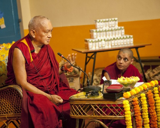 Lama Zopa Rinpoche teaching with Ven. Samten interpreting into Hindi, Maitreya School, Root Institute, Bodhgaya, India, March 2014. Photo by Andy Melnic.