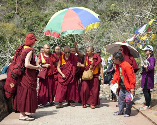 Lama Zopa Rinpoche walking up to Vulture's Peak, India, March 2014. Photo by Andy Melnic.