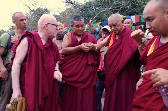 "Ven. Antonio Satta debating with Lama Zopa Rinpoche on the ""merely labeled"" during the hike down from Vulture's Peak, India, March 2014. Photo by Ven. Roger Kunsang."