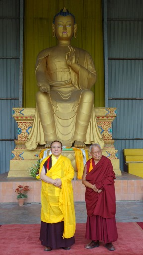 Tai Situ Rinopche and Lama Zopa Rinpoche in front of the 24-foot Maitreya Buddha statue, Bodhgaya, India, March 2014. Photo by Ven. Roger Kunsang.