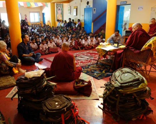 Lama Zopa Rinpoche giving a talk to the students of Maitreya School at Root Institute, Bodhgaya, India, March 2014. Photo by Ven. Roger Kunsang.