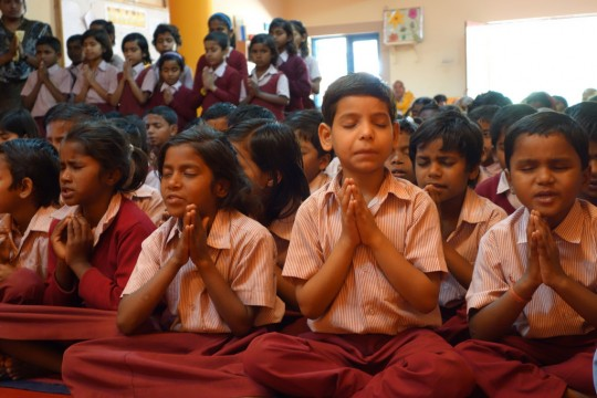 Maitreya School students praying before Lama Zopa Rinpoche's talk, Root Institute, Bodhgaya, India, March 2014. Photo by Ven. Roger Kunsang.