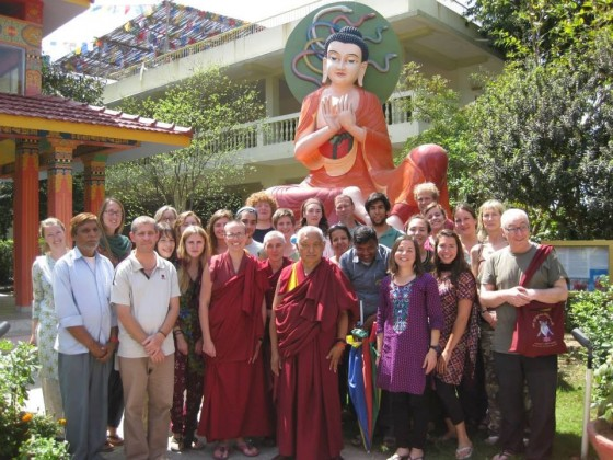 Lama Zopa Rinpoche with the students and staff of Experience Buddhism at the Root, Root Institute, Bodhgaya, India, March 2014. Photo courtesy of Ven. Lozang Khadro.