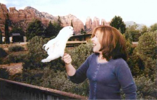 Jetsunma Ahkon Lhamo with Dudtsi, an Umbrella Cockatoo. Photo courtesy of Gardua Aviary of Sedona.