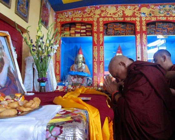 Lama Zopa Rinpoche making offerings to the throne of His Holiness the Dalai Lama on Losar, Root Institute, Bodhgaya, India, March 2014. Photo by Ven. Sarah Thresher.