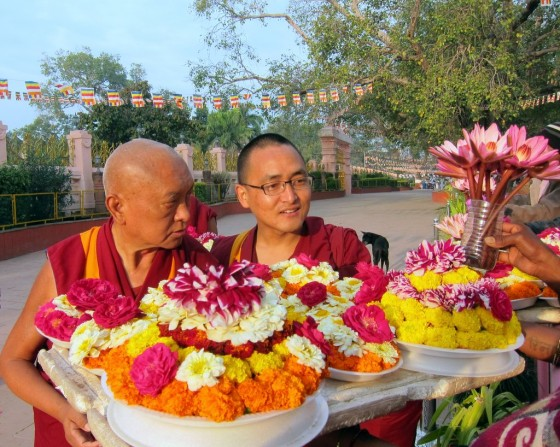 Lama Zopa Rinpoche buying offering at the Mahabodhi Stupa, Bodhgaya, India, February 2014. Photo by Ven. Roger Kunsang.