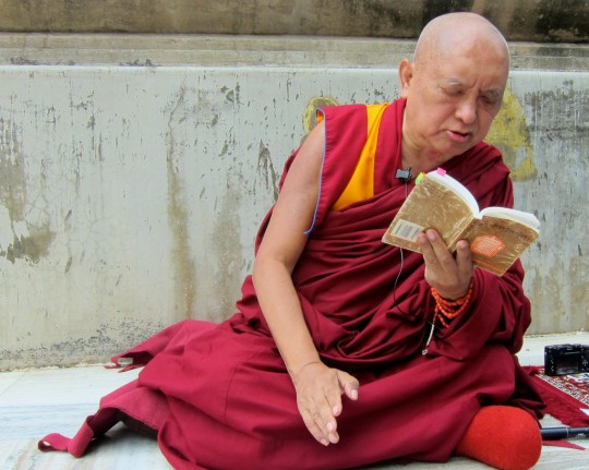 Lama Zopa Rinpoche giving oral transmission of King of Prayers at Mahabodhi Stupa, Bodhgaya, India, February 2014. Photo by Ven. Sarah Thresher.