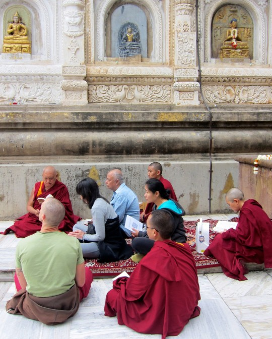 Lama Zopa Rinpoche giving an oral transmission of King of Prayers at Mahabodhi Stupa, Bodhgaya, India, February 2014. Photo by Ven. Sarah Thresher.