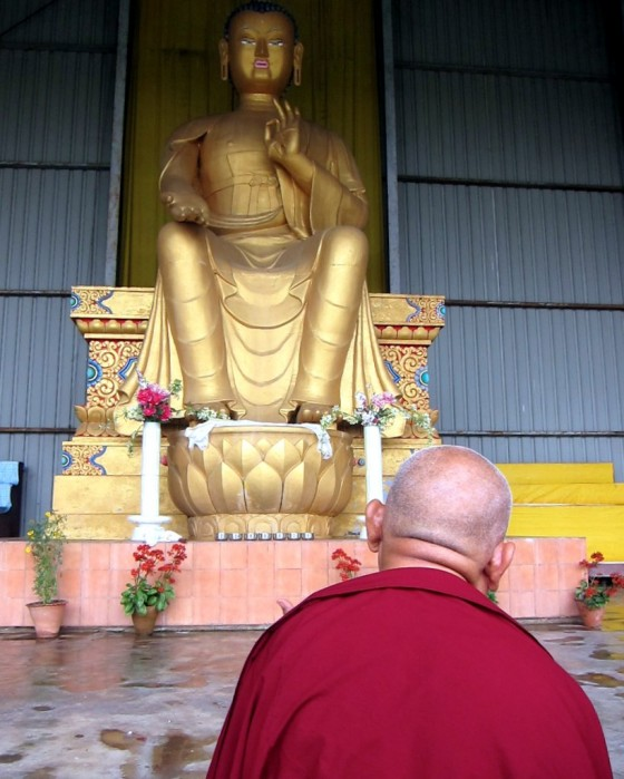 Lama Zopa Rinpoche doing prayers in front of the 24-foot Maitreya statue on the Maitreya Project land in Bodhgaya, India, February, 2014Photo by Ven.Sarah Thresher.