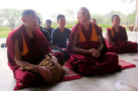 Lama Zopa Rinpoche doing prayers in front of the 24-foot Maitreya Buddha on Maitreya Project land in Bodhgaya, India, February 2014. Photo by Ven. Sarah Thresher.