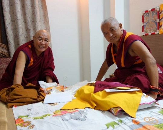 Lama Zopa Rinpoche discussing with Ven. Lobsang Norbu Shastra, a Sanskrit scholar at Sarnath University, the meaning and pronunciation of certain mantras, Sarnath, India, March 2014. Photo by Ven. Roger Kunsang.