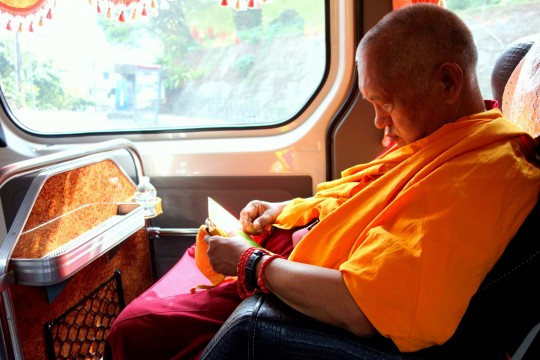 Lama Zopa Rinpoche on the way to opening of renovated Jinsiu Farlin, Taipei, Taiwan, April 2014. Photo by Ven. Roger Kunsang.