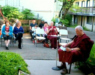 """Ven. Steve Carlier leading """"Prayer to the Six Syllable Great Compassionate One,"""" April 2014. Photo via Facebook, Land of Medicine Buddha."""