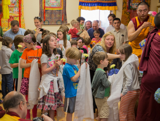 Children offering khatas to Lama Zopa Rinpoche at Kadampa Center, May 3, 2014. Photo copyright David Stravel.
