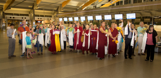 Waiting to meeting Lama Zopa Rinpoche upon his arrival in North Carolina, April 30, 2014. Photo copyright David Strevel.