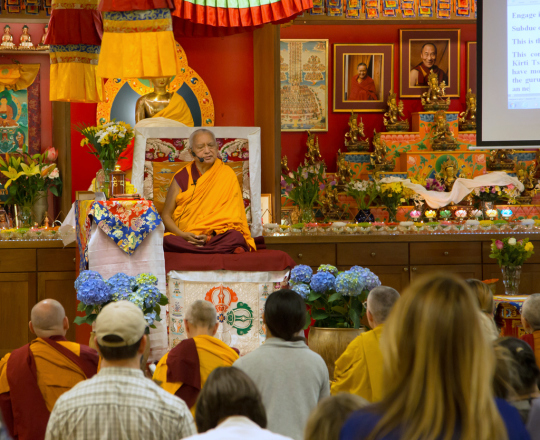 Lama Zopa Rinpoche teaching at Kadampa Center, May 3, 2014. Photo copyright David Stravel.